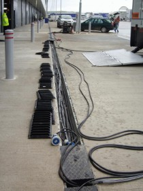Cable in FASERFIX SERVICE CHANNELS in front of team garages
